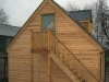 A timber framed garden office with timber cladding