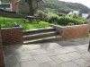 A rebuilt wall and new patio